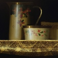 Still life on gold patterned cloth